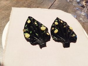 Black garlic oragami leaf with ants Noma best restaurant Copenhagen